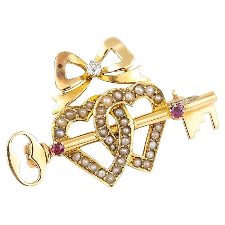 Victorian 15 Karat Gold Pearl Dual Sweet Heart, Ruby Key and Diamond Bow Brooch For Sale