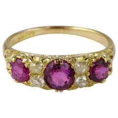 Victorian 1.55 Carat Natural Burmese Ruby .40 Carat Old Diamond Seven-Stone Ring