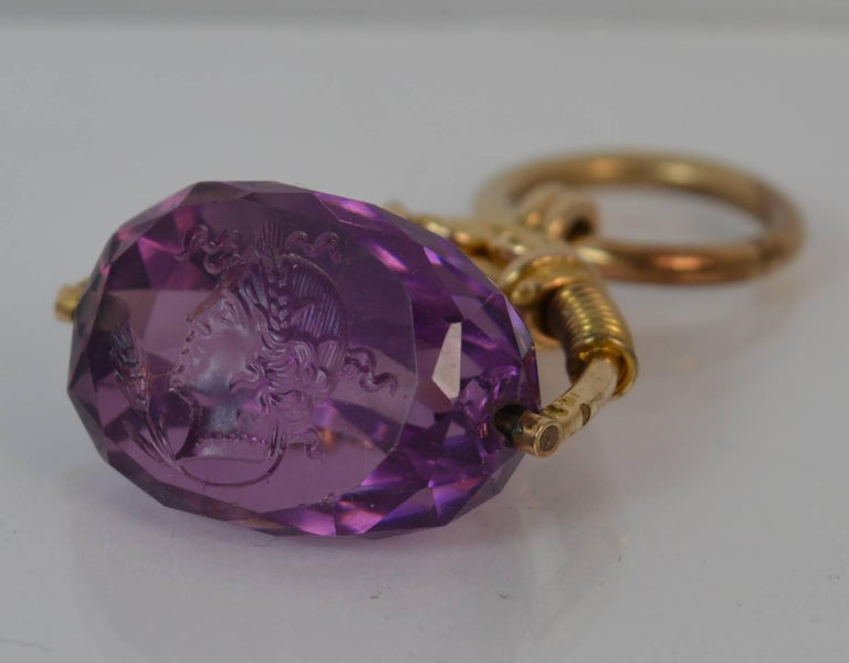 Victorian 15 Carat Gold and Amethyst Intaglio Swivel Fob Pendant In Excellent Condition For Sale In St Helens, GB