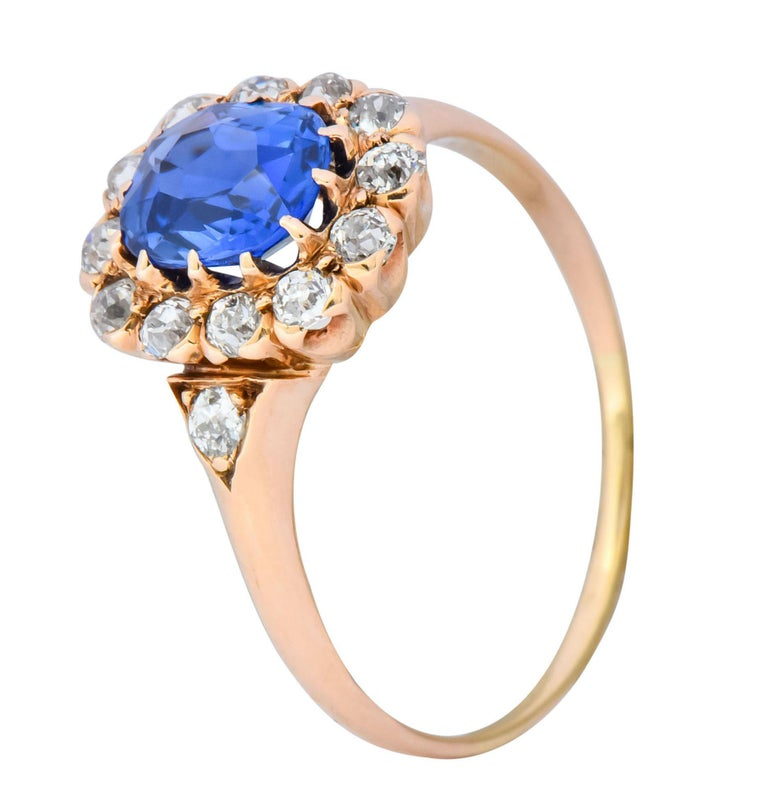 Centering an oval cut Kashmir sapphire weighing 1.10 carat, bright blue with no evidence of heat treatment   With an old European cut diamond surround and accents, total diamond weight approximately 0.50 carat, G to J color and VS to SI