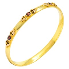 Victorian 1.65 Carat Garnet 14 Karat Two-Tone Gold Bangle Bracelet