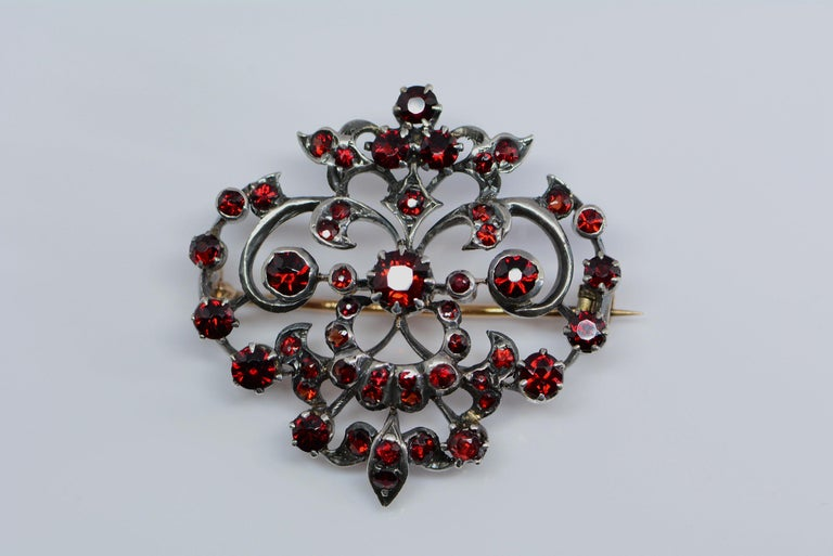 This brooch is a good example of how the victorians used silver on top of gold to prevent silver tarnish from staining the skin or clothes and to still have the desired look of a white metal.  This method was used before white gold was invented or