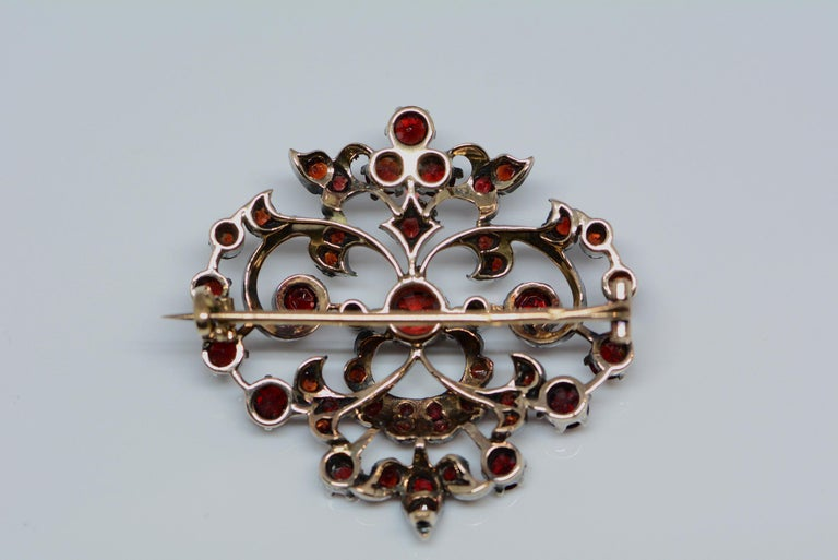 Women's or Men's Victorian 1.65 Carat Total Weight Garnet Brooch Silver and Yellow Gold For Sale