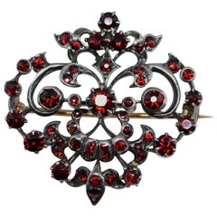 Victorian 1.65 Carat Total Weight Garnet Brooch Silver and Yellow Gold
