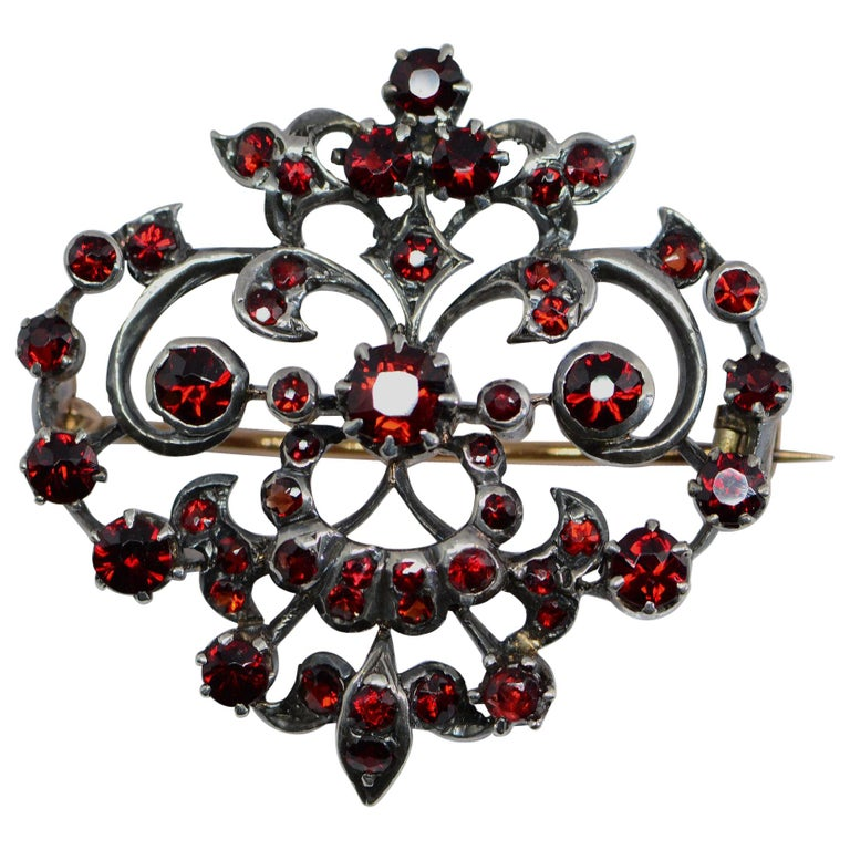 Victorian 1.65 Carat Total Weight Garnet Brooch Silver and Yellow Gold For Sale