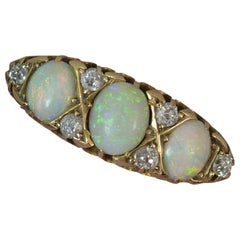 Victorian 18 Carat Gold Natural Opal and Old Cut Diamond Cluster Ring
