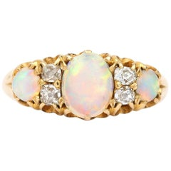 Victorian 18 Karat Gold Opal and Diamond Three Stone Gypsy Ring, circa 1890