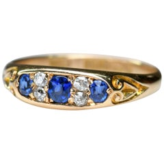 Victorian 18 Karat Gold Three-Stone Sapphire and Diamond Ring