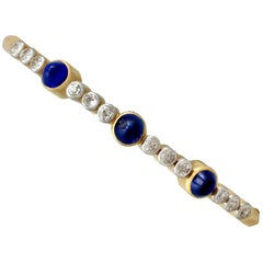 Victorian 1895 4.48 Carat Sapphire 1.20 Carat Diamond Yellow Gold Bangle