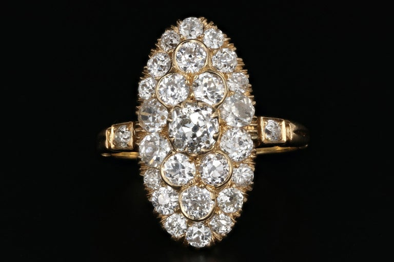 Era: Victorian  Composition: 18K Yellow Gold  Primary Stone: Old Mine Cut Diamond  Stone Carat Weight: .53 Carats  Color/ Clarity: J/SI2  Accent Stone: Old European Cut Diamonds  Accent Stone Carat Weight: 1.80 Carats  Color/ Clarity: I/J,