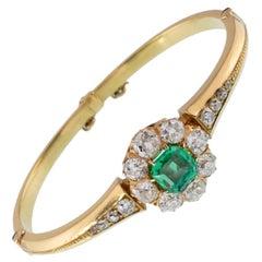 Victorian 18 Karat Gold and 2.0 Carat Emerald and 3.0 Carat Diamond Halo Bangle