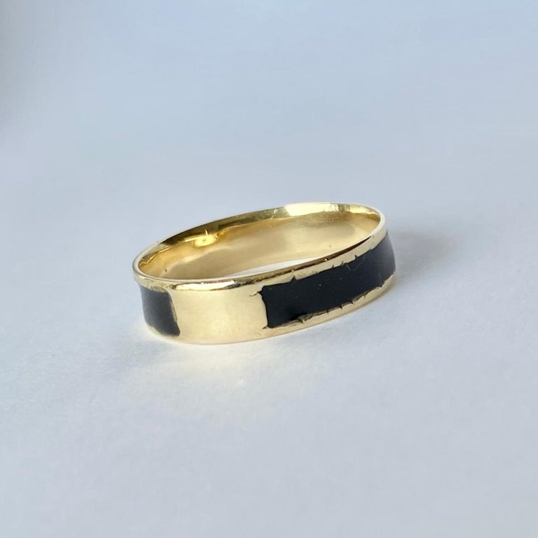 A superb antique victorian mourning ring. This is set with glossy black enamel around the ring.  Ring Size: O or 7 1/4 Band Width: 5mm  Weight: 1.3g