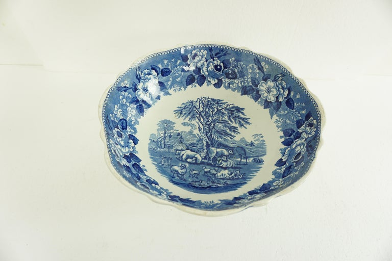Large Victorian Adams Ironstone Blue, white transfer punch bowl, English 1850 B1642  England 1850 Fully mounted to the base The bowl which is raised on a deep foot is decorated with a central farm scene Surrounded with a lovely floral