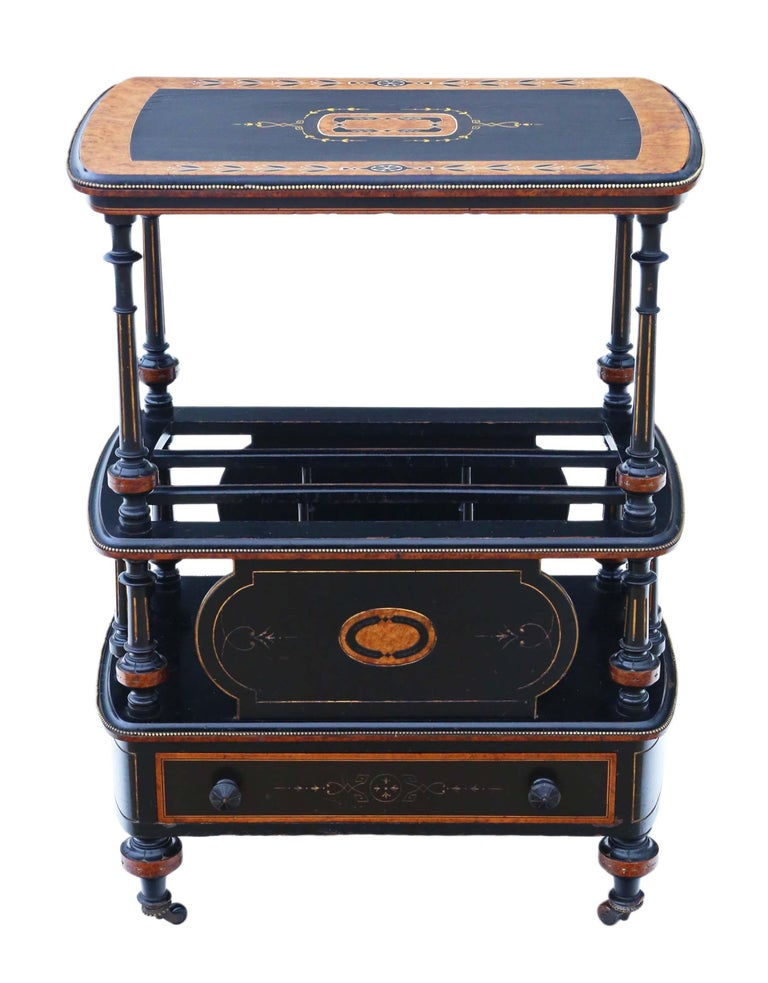 Antique quality Victorian Aesthetic circa 1880 ebonised with inlaid amboyna and brass edging Canterbury whatnot. This is a lovely item, that is full of age, charm and character. An attractive and rare quality piece, with a lovely decorative