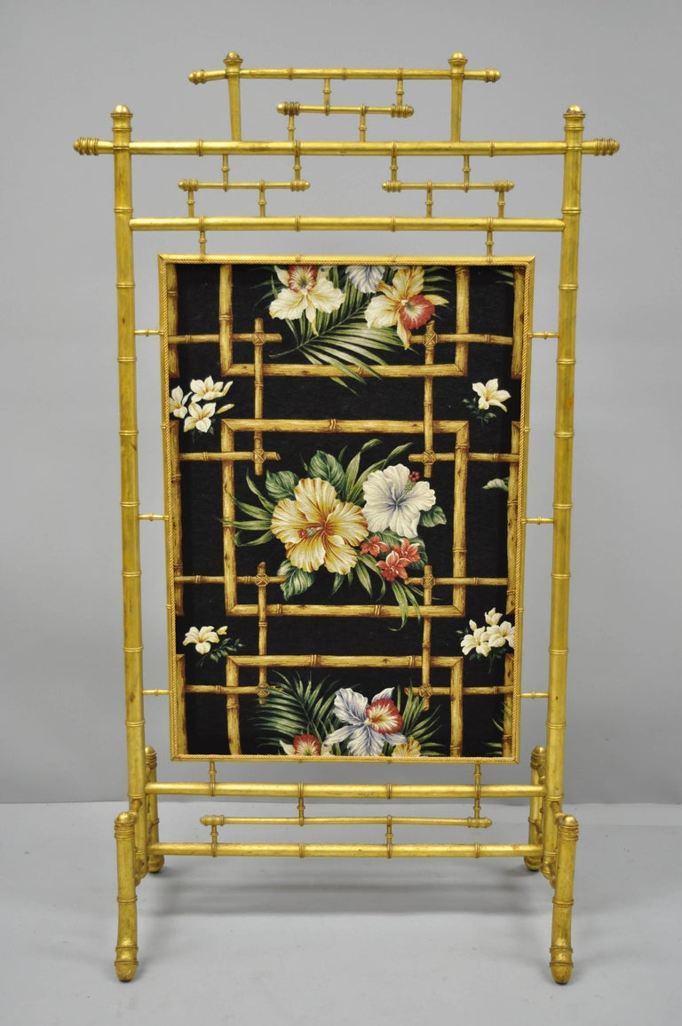 Antique Victorian aesthetic movement gold gilded faux bamboo fire screen with floral silk fabric panel. Item features gold giltwood construction, floral silk fabric with bamboo pattern, carved faux bamboo design, very nice antique item. Believed to