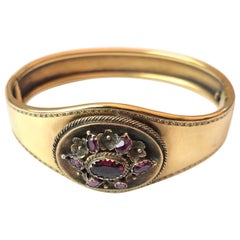 Victorian Almandine Garnet and 18 Carat Gold Locket Back Bangle