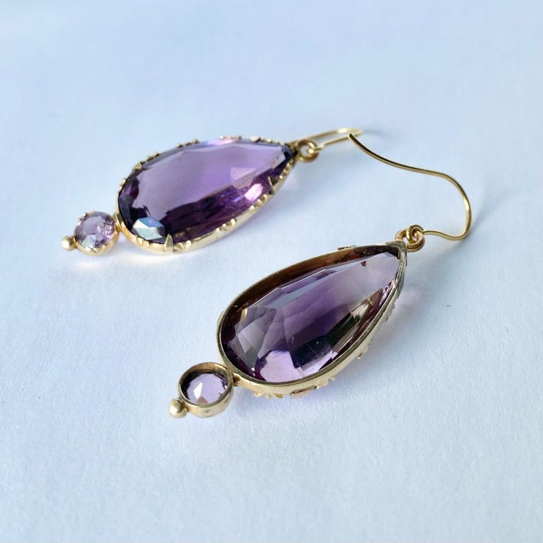 Striking victorian Amethyst drop earrings with charming detail around the setting. These earrings are modelled in 9ct gold.   Total drop from ear: 47mm  Weight: 9g