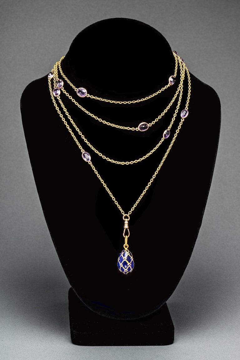 A luscious antique gold longchain from the Victorian era, designed as a line of oval gold links alternating with sixteen oval-cut faceted amethysts each set within a gold bezel, attached to a swivel clasp. May also be worn as a double or triple