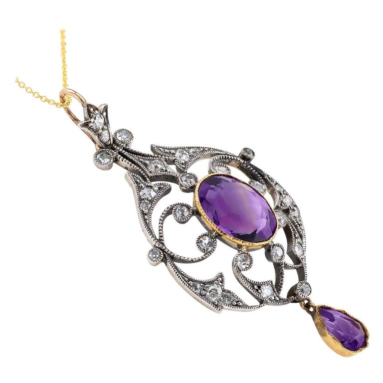 Victorian amethyst old mine-cut diamonds silver and gold pendant circa 1890.  DETAILS: DIAMONDS:  twenty-eight old mine-cut diamonds totaling approximately 0.90 carat, approximately I – K color and SI – I clarity. GEMSTONES:  two amethyst, one oval;