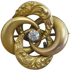 Victorian Antique Diamond Brooch, Gold Engraved Knot, circa 1890s, 15 Carat Gold