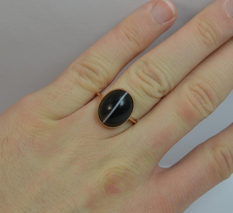 An antique 9 carat rose gold and single banded agate ring.  11.7mm x 14.3mm agate. 2.9 grams. Protruding 7mm off the finger.  Size M 1/2 UK, 6 1/2 US  Great overall condition. Clean stone. Clean and solid shank.