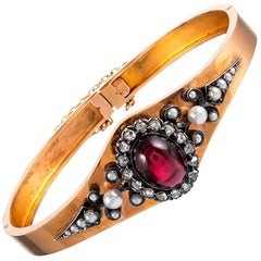 Victorian Bangle Bracelet with Cabochon Garnet, Pearls and Diamonds