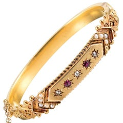 Victorian Bangle Bracelet with Etruscan Detail and Ruby, Diamond and Pearls