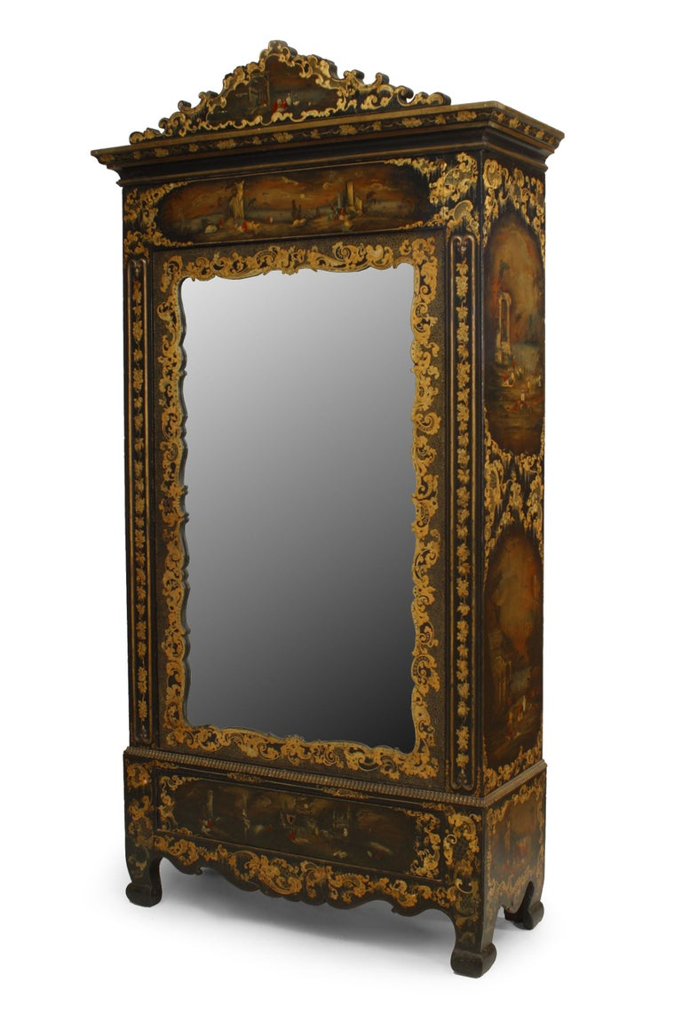English Victorian black lacquered armoire with gilt embellishments, painted Moorish scenes, and mirrored door.