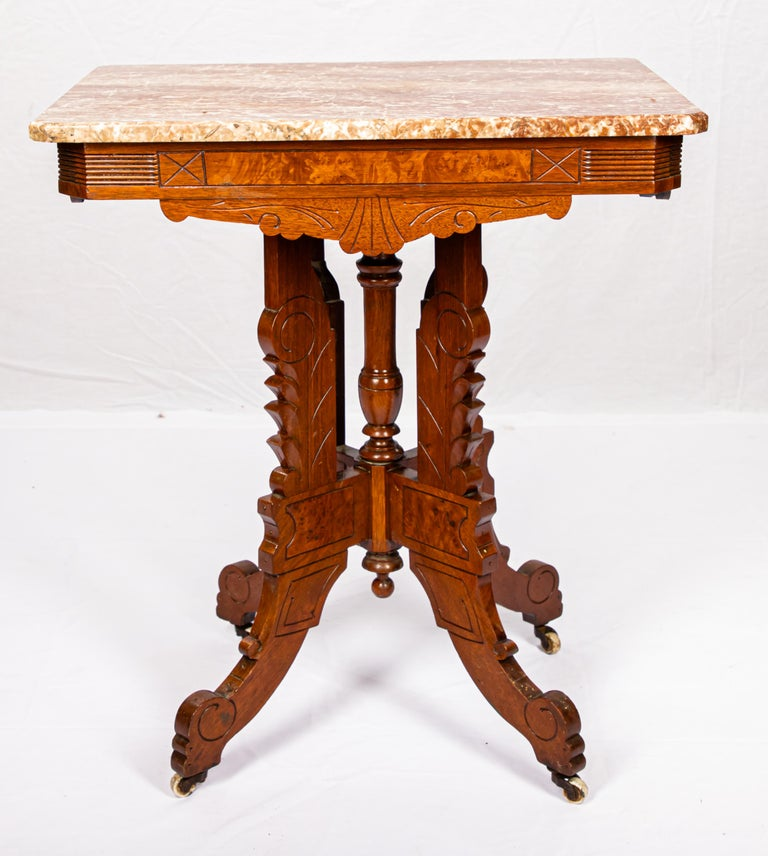 Offering this beautiful Victorian parlor table. Sitting on a pedestal base it rises to a simple skirt with geometric lines. Has a blush colored marble-top.