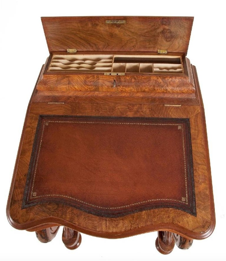 A good Victorian burr walnut Davenport.