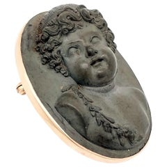 Victorian Carved Lava and 14 Karat Gold Cameo Attendant of Bacchus