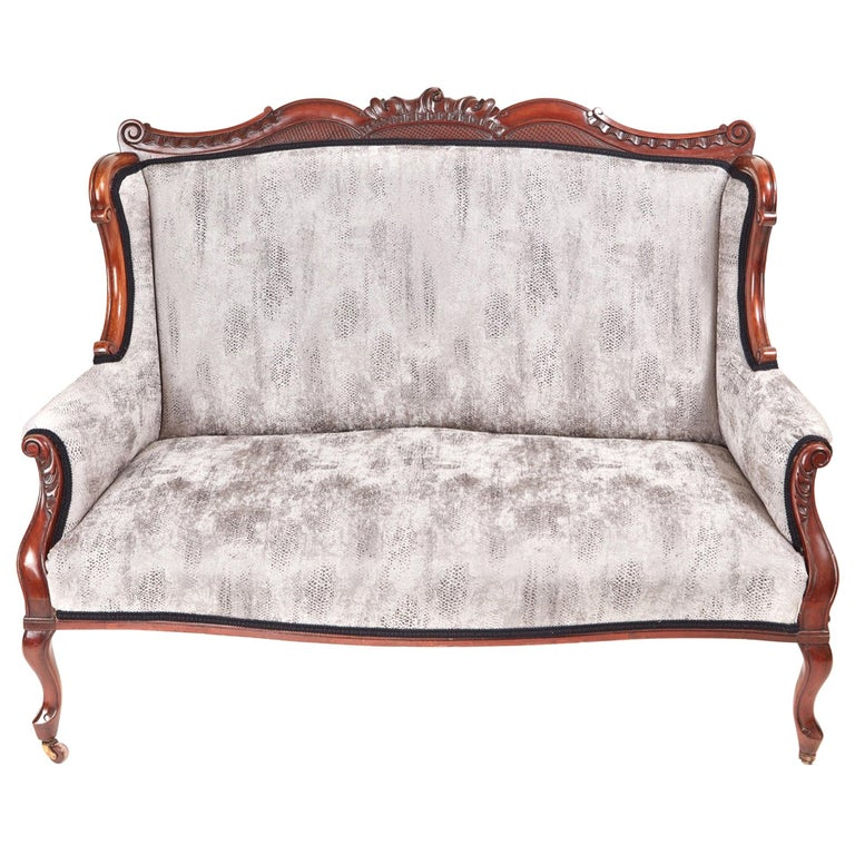 Victorian Carved Mahogany Settee For Sale