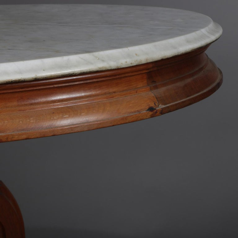Victorian Carved Walnut Marble-Top Oval Center Table, circa 1890 1