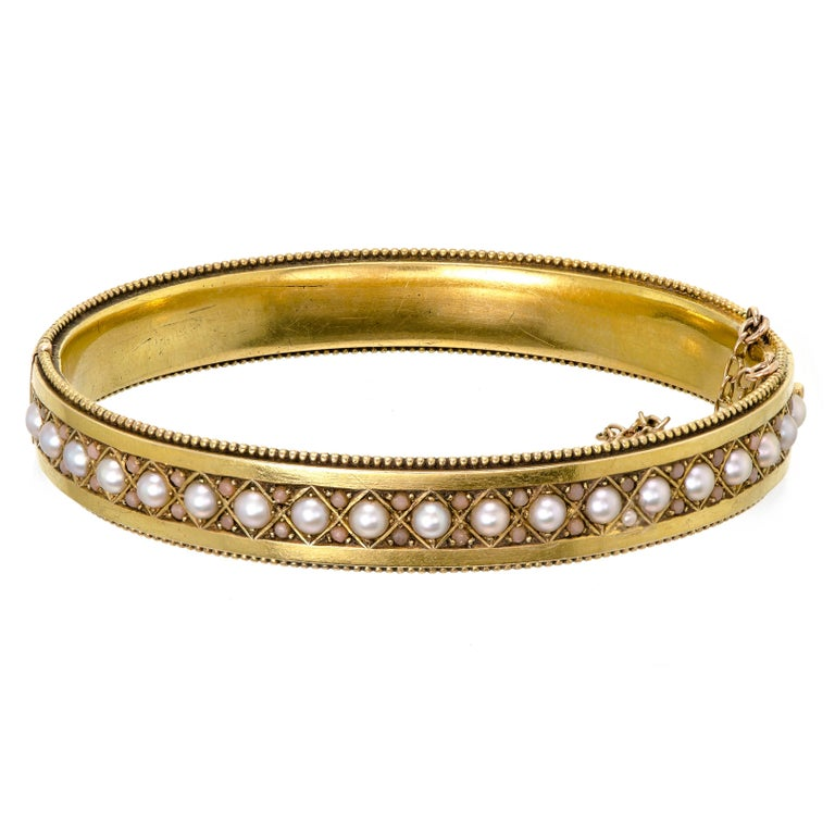 Victorian Pearl and Light Coral Yellow Gold Stiff Hinged Yellow Gold, circa 1895