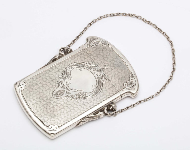 Victorian, Coin Silver (.900) calling card/ business card holder, Gorham Manufacturing Co., Providence, Rhode Island, circa 1860-1870. Two figures (one on each side) are holding the case's original, silver link chain. Engine turned design. Has a