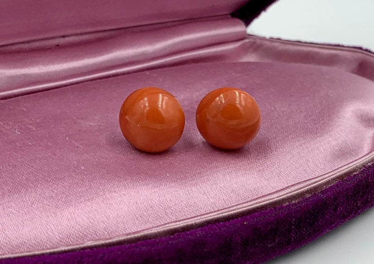 A gorgeous pair of Victorian Coral Earrings in 9 Karat Gold.  The stunning earrings have round natural Coral cabochons of 14mm (just over 1/2 inch) in diameter.  The color of the coral is a warm lovely salmon with a touch of red.   The size is