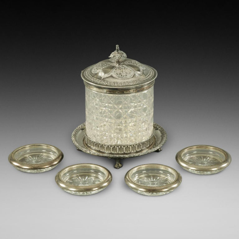 Victorian cut glass and silver plate mounted biscuit barrel, on four claw and ball feet, and four cut glass coasters with silver plate mounts 6