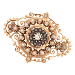 Victorian Diamond and Half-Pearl Brooch in 18 Karat Rose Gold and Silver