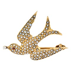 Victorian Diamond Garnet Seed Pearl Swallow Bird 14 Karat Gold Brooch