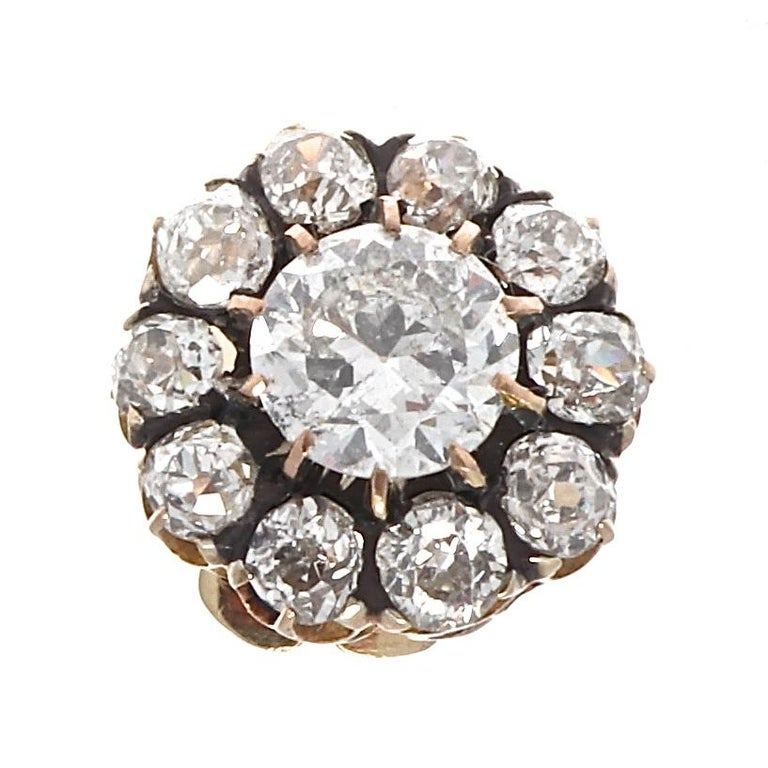 The Victorian earrings are approximately 3.60 carats in total. Classic design for everyday wear as well as an evening out. Featuring approximately 1 carat old European cut diamonds in each earring that are H-I color, SI clarity. Surrounded by halos