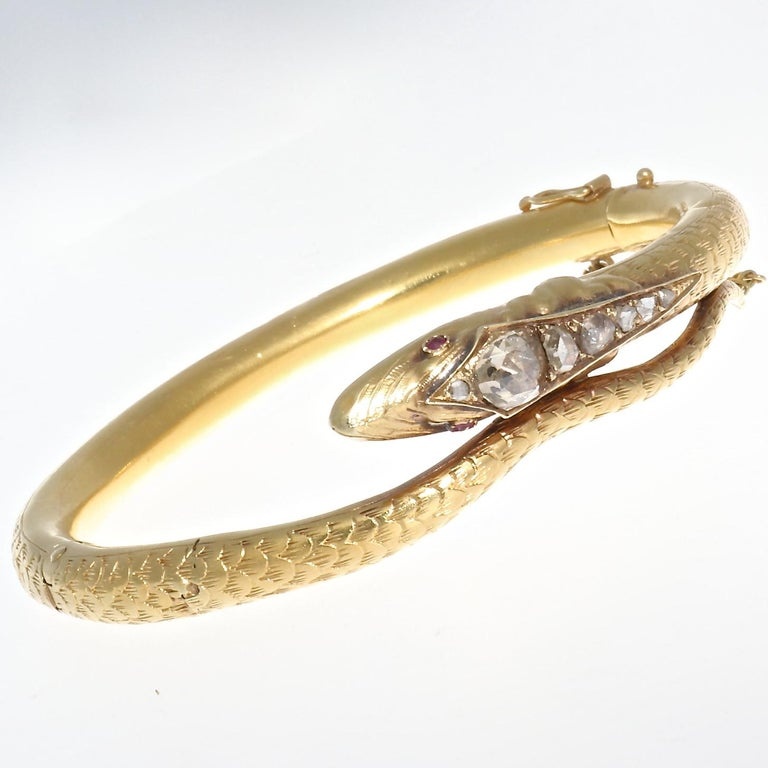 Exquisite 18k yellow gold Victorian snake bangle from Holland, circa 1880. Featuring 6 rose cut diamonds approximately H-I in color, adorning the perfectly sculpted head of the snake, and total approximately one carat. With ruby eyes that are