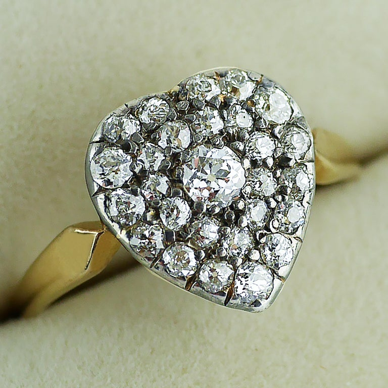 18ct gold and silver set Victorian Diamond Heart shaped ring, circa 1870.   Heart shaped design in 18ct yellow gold and silver set with 27 old cut, well matched diamonds. The ring shank in 18ct yellow gold with a fine pierced gallery and fret work