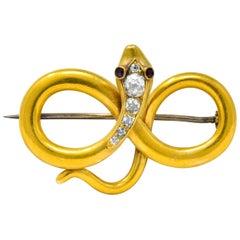Victorian Diamond Ruby 18 Karat Gold Infinity Snake Brooch, circa 1900