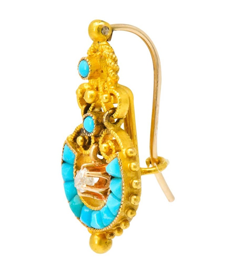 Each centering an articulated, claw set, old mine cut diamond, weighting approximately 0.20 carat total, eye-clean   Accented with round cabochon and calibré cut turquoise  Textured scrolling and polished gold bead detailing  With French
