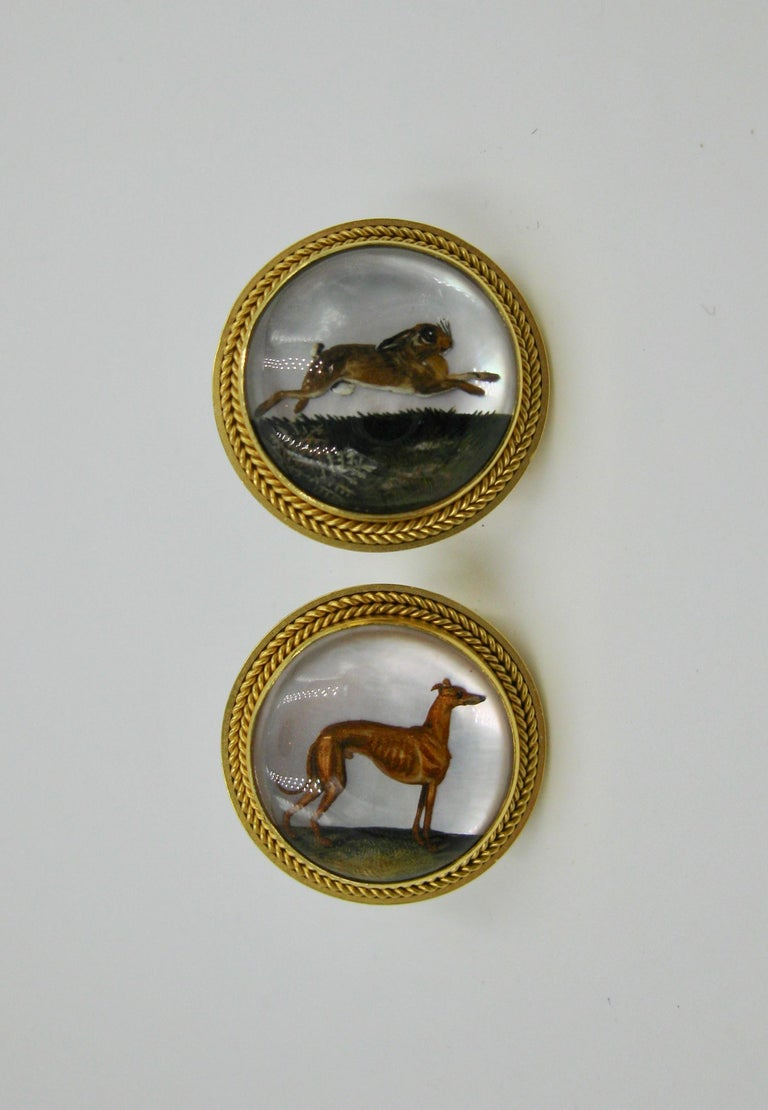 A gorgeous and very rare pair of large one inch Antique Victorian Etruscan Revival Essex Crystal Earrings with images of a dog and a rabbit, or hound and hare and set in 15 Karat Gold.  These are spectacular Museum Quality earrings.  The Essex