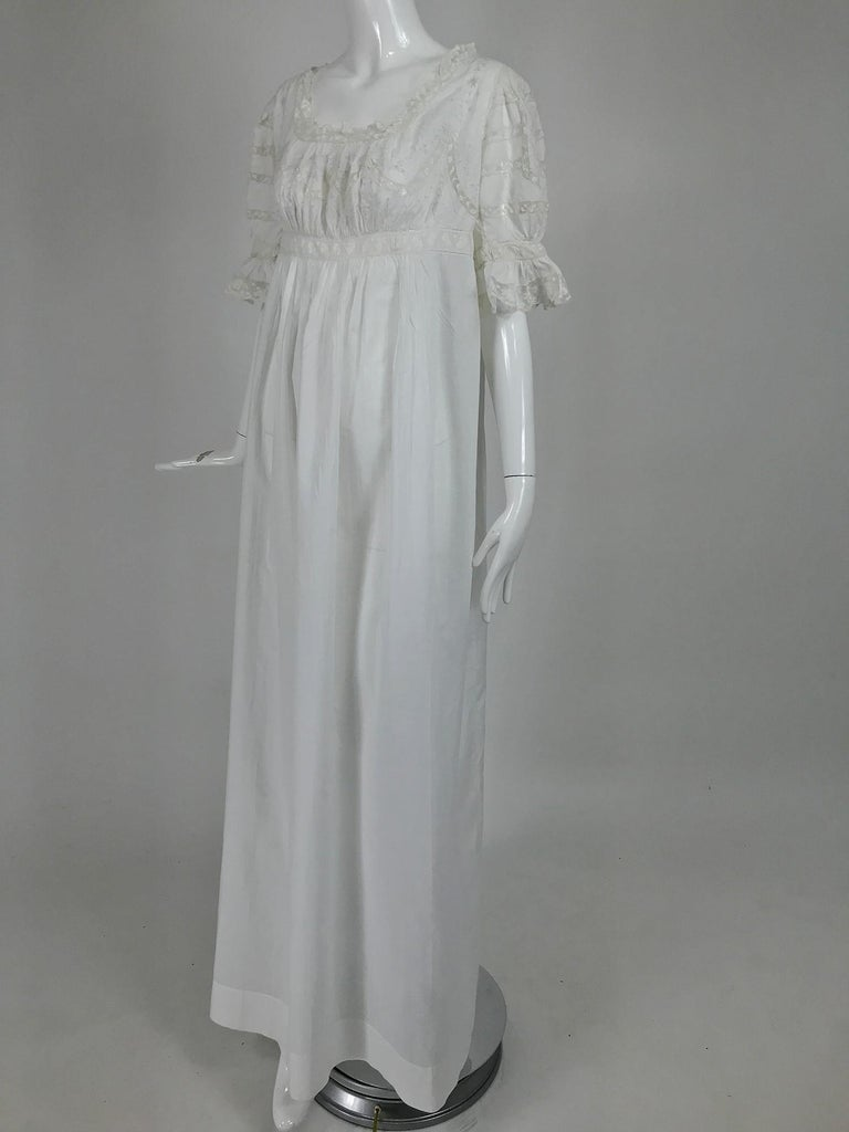 Victorian embroidered cotton batiste lace gown embroidered with the name Hattie from the early 1900s. This beautiful gown was never worn, it still has the pencil order number written on the upper back. It has the name of the owner Hattie embroidered