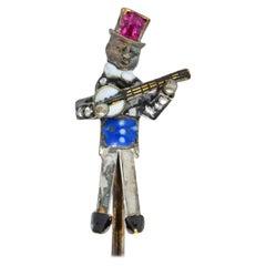 Victorian Enamel Diamond Ruby 14 Karat Gold Banjo Player Stickpin