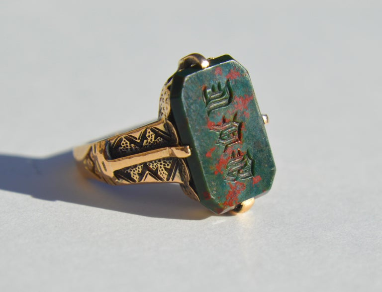 Lovely Victorian era late 1800s bloodstone signet ring set in 14K yellow gold. The letters or symbols are ornate and difficult to decipher. Size 6. In good condition. Bloodstone measures 13x9mm. Unmarked, but tested as solid 14K gold.   Bloodstone