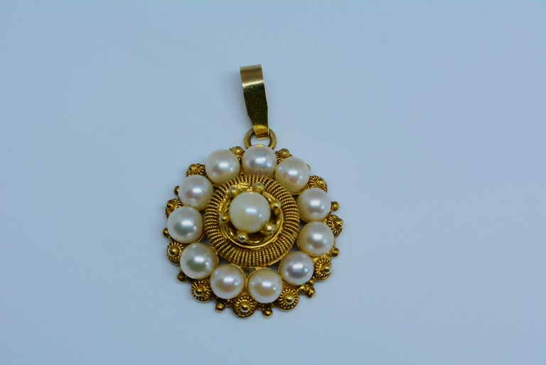 You don't come across these everyday. The workmanship to make cannetille jewellery is quite difficult and considered a lost art in jewellery making.  The cultured pearls may have been replaced at some point in time- it is possible the originals were