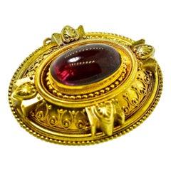 Victorian Etruscan Revival Garnet Antique Brooch, circa 1880